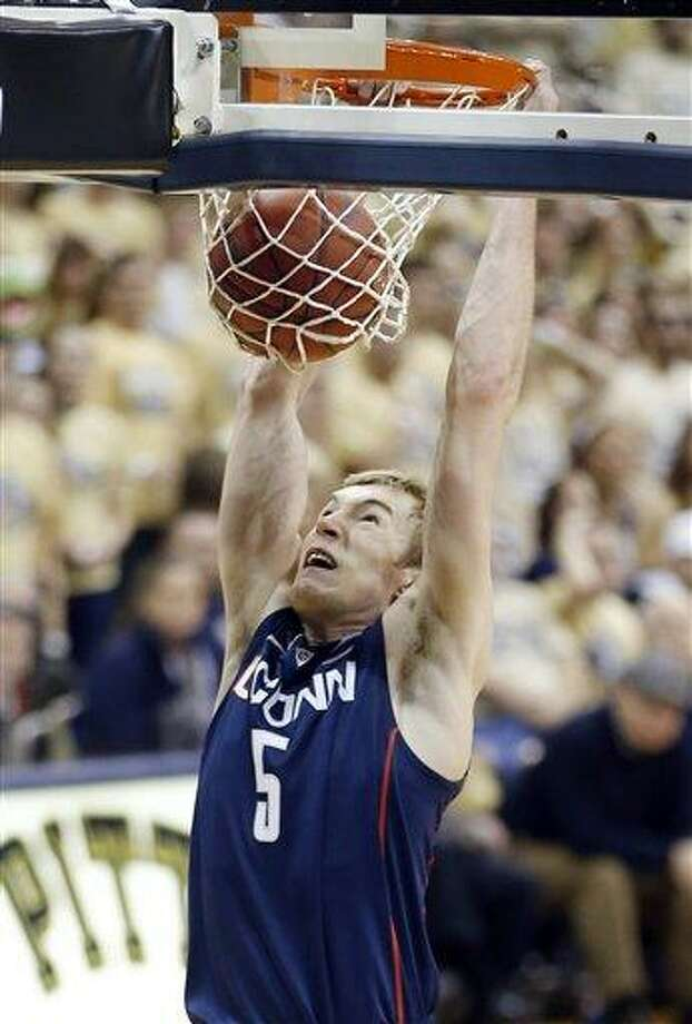 Connecticut's Niels Giffey (5) dunks against Pittsburgh during the second half of an NCAA college basketball game, Saturday, Jan. 19, 2013, in Pittsburgh. Pittsburgh won 69-61. (AP Photo/Keith Srakocic) Photo: ASSOCIATED PRESS / AP2013