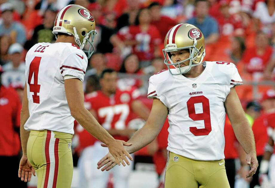 San Francisco 49ers kicker Phil Dawson (9) is congratulated by holder Lavelle Hawkins (4) following a field goal during the first half of an preseason NFL football game against the Kansas City Chiefs at Arrowhead Stadium in Kansas City, Mo., Friday, Aug. 16, 2013. (AP Photo/Charlie Riedel) Photo: AP / AP