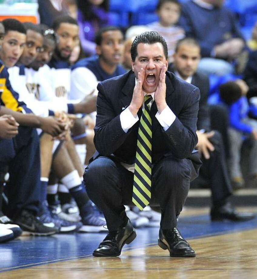 Hamden-- Quinnipiac basketball coach Tom Moore during the teams' game against Maine. Maine won 76-71. Photo-Peter Casolino ,
