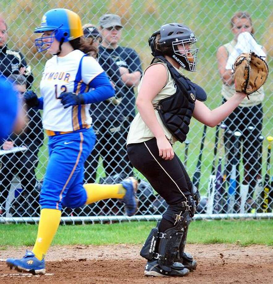 Makayla O'Hara (left) of Seymour scores on an inside the park home run against Woodland on 5/8/2013.Photo by Arnold Gold/New Haven Register   AG0496C