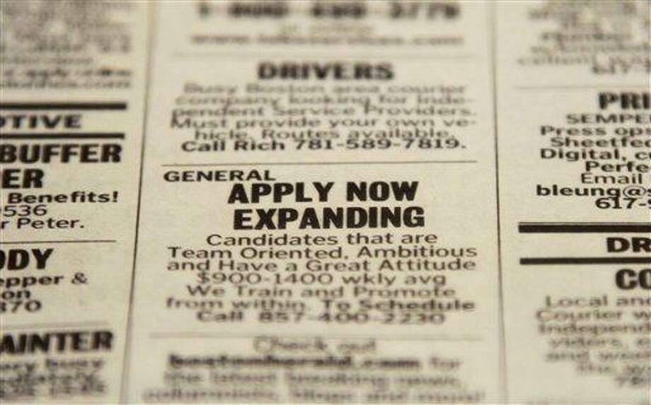 An advertisement in the classified section of the Boston Herald newspaper on Dec. 11 calls attention to possible employment opportunities. Associated Press file photo Photo: ASSOCIATED PRESS / The Associated Press2012