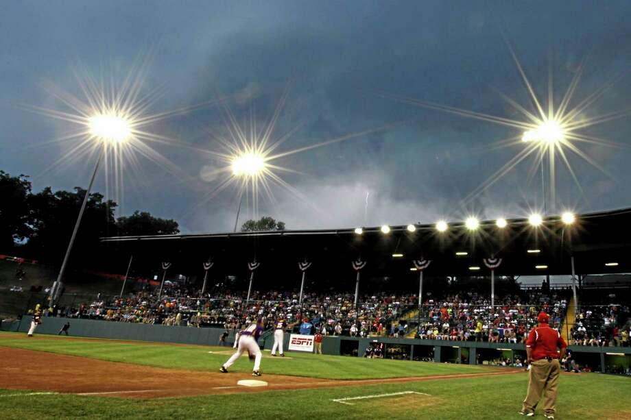 Clouds cover the sky behind Lamade Stadium. Westport had its game against Washington postponed to today at 3 p.m. Photo: Matt Slocum — The Associated Press   / AP