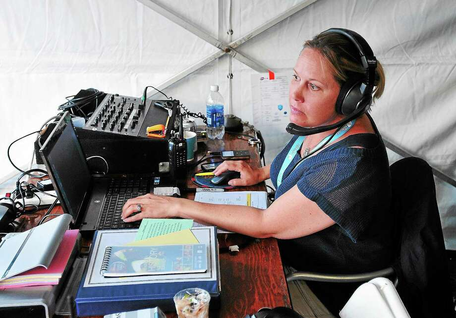 Peter Casolino — RegisterErin Wolfe, stadium producer at the New Haven Open at Yale tennis tournament, works the controls during the Caroline Wozniacki vs Sloane Stephens evening match.pcasolino@newhavenregister.com Photo: Journal Register Co.