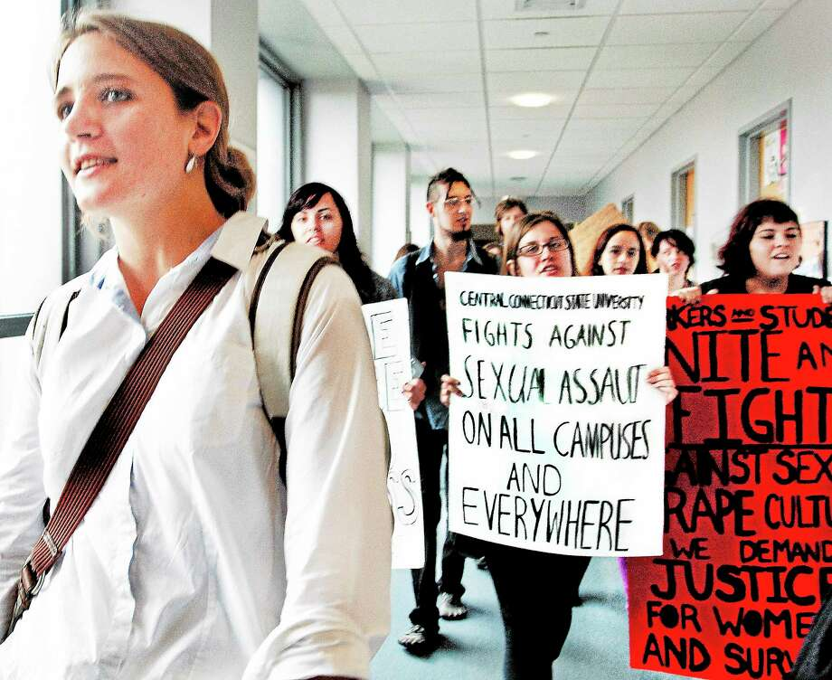 (Melanie Stengel — New Haven Register )    Southern Connecticut State University graduate Wendy Wyler leads a group pf protesters through Engleman Hall, to the President's office. The students and alumni came from colleges accross the state. Wyler is suing the University in a case where she claims that she was sexually hatrrassed. Photo: Journal Register Co.