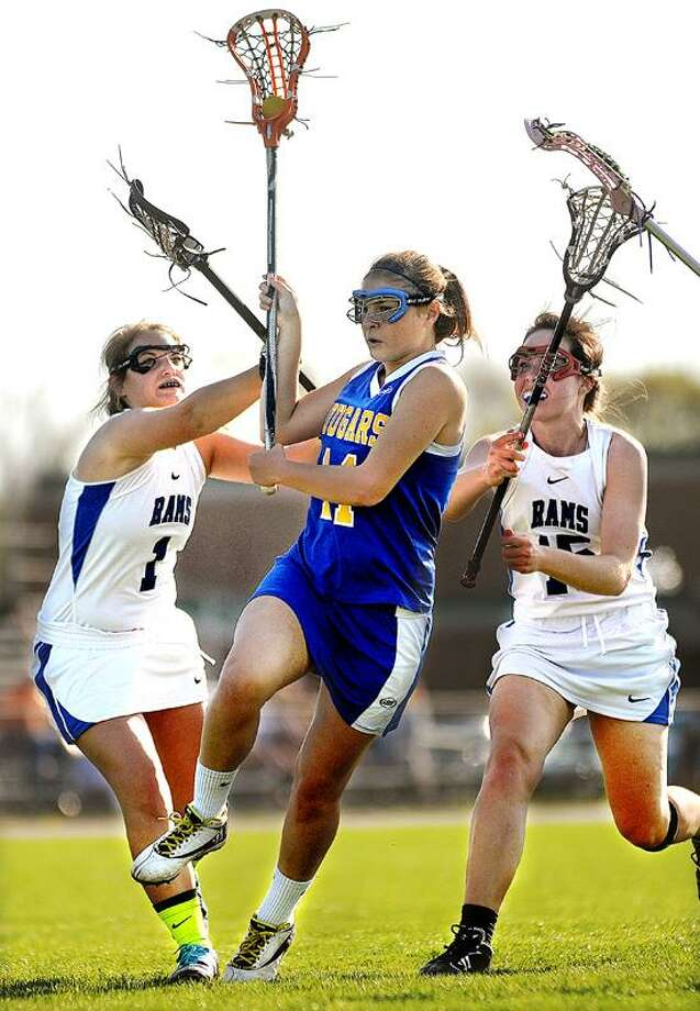Catherine Avalone/The Middletown PressHaddam-Killingworth junior Susanne Pasqualini plows through Old Saybrook defenders Julia DePalermo (1) and Hudson Roarick (15) Thursday afternoon in Old Saybrook to score. H-K defeated Old Saybrook 17-9. / TheMiddletownPress