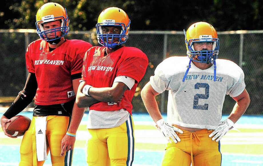 Mara Lavitt — Register August 20, 2013 West Haven. University of New Haven's football team during scrimmage. Mike DeCaro, right, with backup QBs Will Clements, left, and Ajee Patterson. Photo: Journal Register Co.