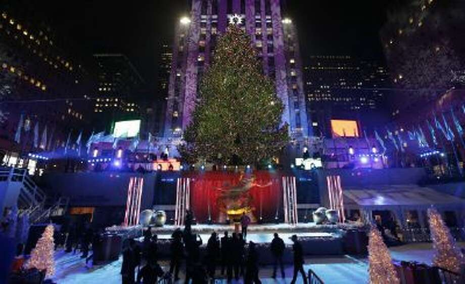 This Dec. 4, 2013 file photo shows the Rockefeller Center Christmas tree in New York. It's that time of year: holiday music time. And with holiday music comes all the strange and twisted things we sometimes think we're hearing. Mondegreens, the moniker for misheard words in song, aren't restricted to holiday standards, of course, but the old-timey language of some seems to serve as a botched-lyric magnet.