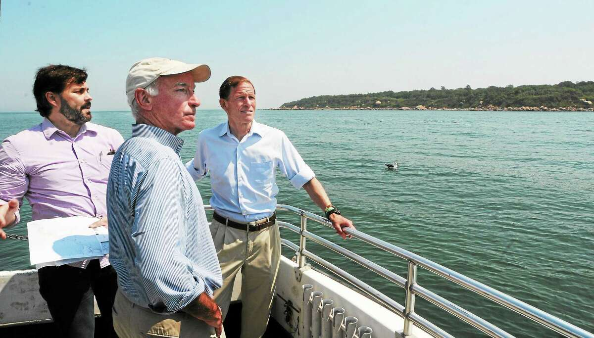 Mara Lavitt — Register August 21, 2013 US Congressman Joe Courtney, D-2, and US Senator Richard Blumenthal toured the waters off Plum Island, bringing attention to the environmental fate of the island. Charles Rothenberger, staff attorney for Save the Sound, left, familiarizes the legislators with the layout of the island.