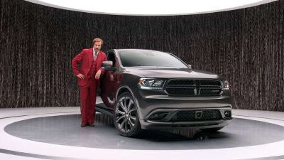 """This undated photo provided by Chrysler shows Will Ferrell as """"anchorman"""" character Ron Burgundy in an advertisement for the 2014 Dodge Durango. Photo: AP / AP2013"""