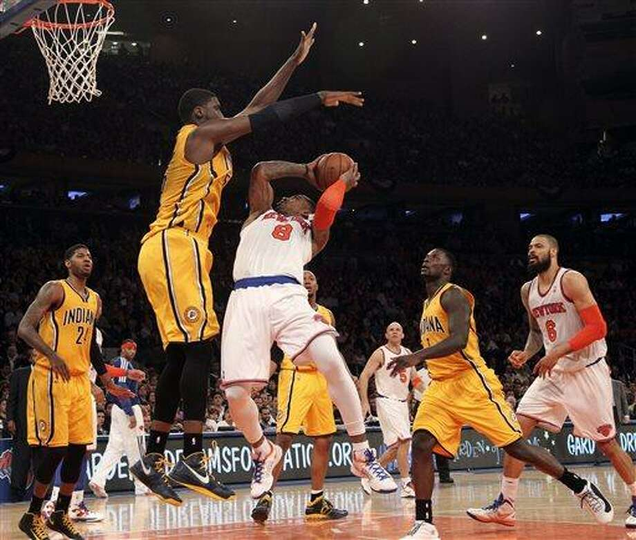 Indiana Pacers' Roy Hibbert, second from left, blocks New York Knicks' J.R. Smith from going to the basket in the second half of Game 2 of their NBA basketball playoff series in the Eastern Conference semifinals at Madison Square Garden in New York, Tuesday, May 7, 2013. The Knicks won 105-79. (AP Photo/Mary Altaffer) Photo: AP / AP
