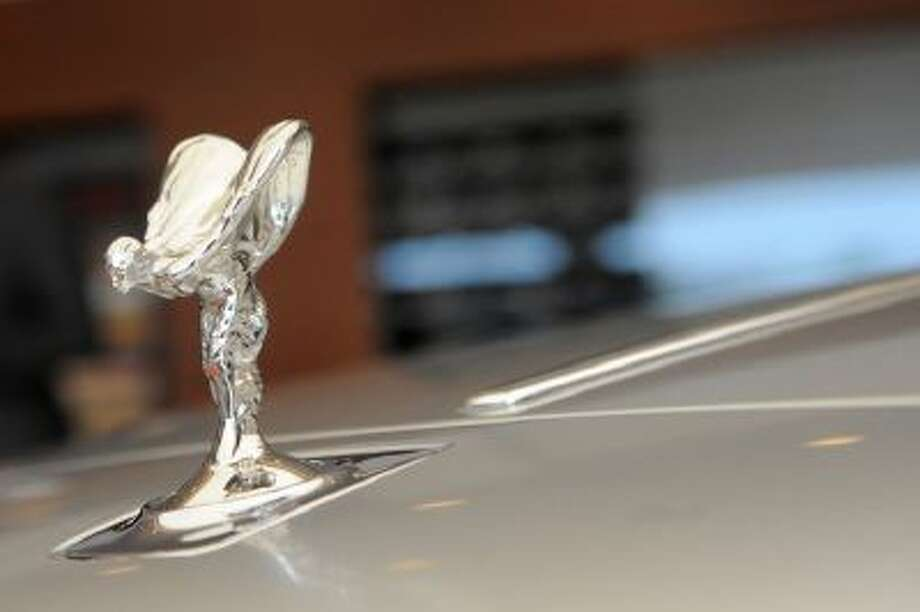 The hood ornament of a Rolls-Royce Ghost car. Rolls-Royce CEO Torsten Müller-Ötvös said the firm known for its stately sedans is now in the early stages of designing its first SUV for the super rich.
