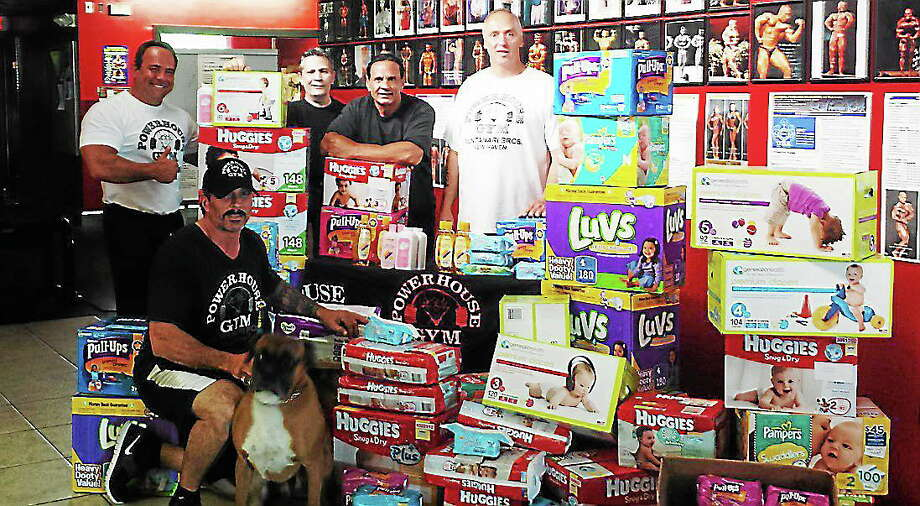 The contributed picture shows, l to r: Kenny Wallach, Powerhouse Trainer; Richard Montanari, Powerhouse Owner and gym owner of 31 years in the area; Jerry Montanari, Powerhouse Owner; Tony Croce, Coordinator of Drive and Powerhouse Staff. On the floor in front is Darren Montanari, Powerhouse Owner and the dogs name is Romeo. The picture was taken by a Powerhouse Member, Michelle Criscuolo. Photo: Journal Register Co.