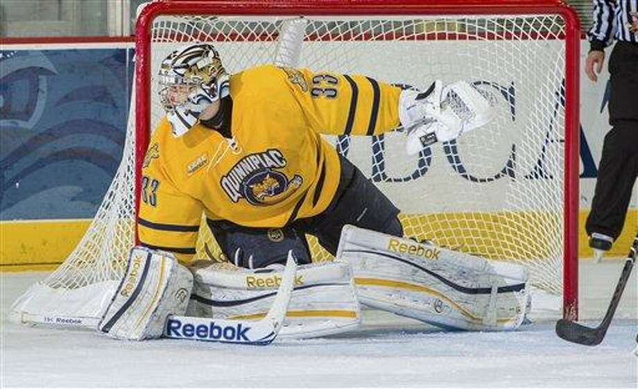 In this Dec. 7, 2012, photo provided by Quinnipiac University, Quinnipiac goalie Eric Hartzell guards the net in a game against Princeton in Hamden. Conn. The Bobcats are 18-3-3, unbeaten in their last 17 games and ranked second in the nation on Jan. 29. Hartzell leads the nation with a goals-against average of 1.46. (AP Photo/Quinnipiac University, John Hassett) Photo: ASSOCIATED PRESS / John Hassett 2012. All rights reserved2012