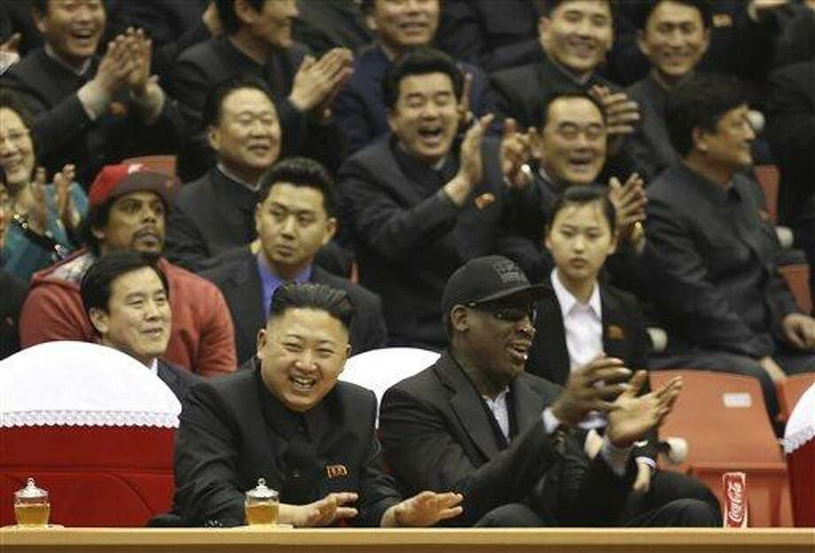 """FILE - In this Thursday, Feb. 28, 2013 file photo released by VICE Media, North Korean leader Kim Jong Un, left, and former NBA star Dennis Rodman watch North Korean and U.S. players in an exhibition basketball game at an arena in Pyongyang, North Korea. Rodman is tapping his friendship with Kim Jong Un to call for the release of a Korean-American man detained in the North. In a tweet on Wednesday, May 8, 2013, Rodman called on Kim """"to do me a solid and cut Kenneth Bae loose."""" (AP Photo/VICE Media, Jason Mojica, File) Photo: AP / VICE Media"""