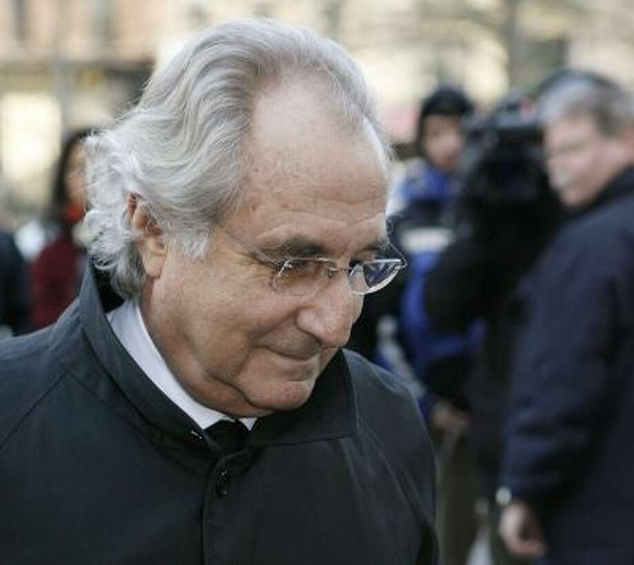 In this Jan. 14, 2009 file photo, Bernard Madoff arrives at Federal Court in New York. The longtime secretary of the imprisoned financier and four other back-office subordinates of the Ponzi king go to trial Tuesday. Photo: AP / FR70043 AP