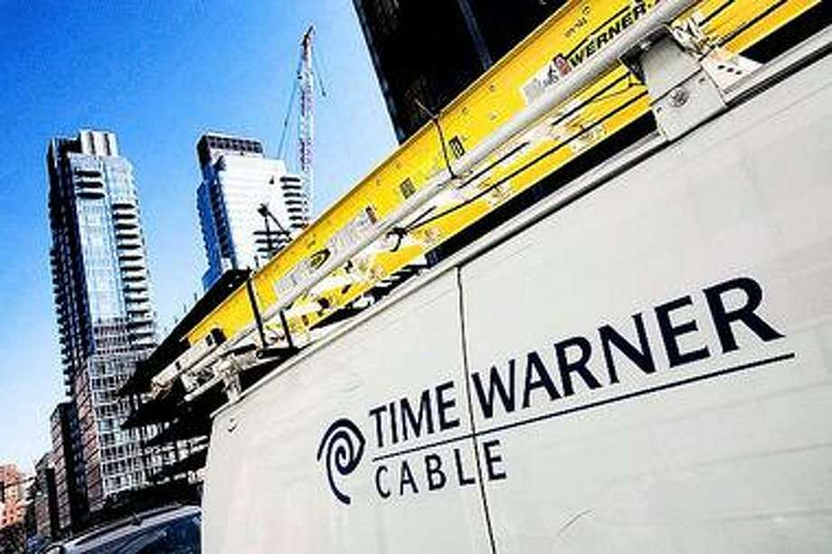 FILE - In this Feb. 2, 2009 file photo, a Time Warner Cable truck is parked in New York. Time Warner Cable Inc. customers from Portland, Maine, to Pensacola, Fla., could lose access to one of their network TV stations 12:00 a.m. EST Saturday, Jan. 1, 2011, because of a contract dispute with Sinclair Broadcast Group. (AP Photo/Mark Lennihan, file) Photo: AP / AP2009