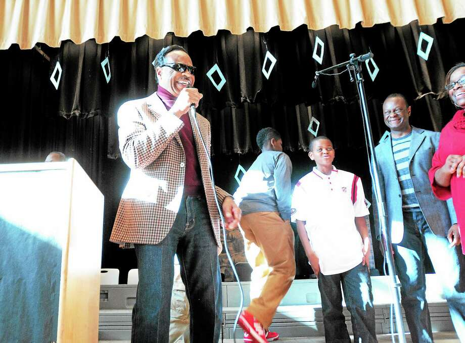 Musician Edwin Hawkins (left)finishes his performance with students at the King/Robinson Interdistrict Magnet School in New Haven on 12/11/2013. Photo: (Arnold Gold - New Haven Register)