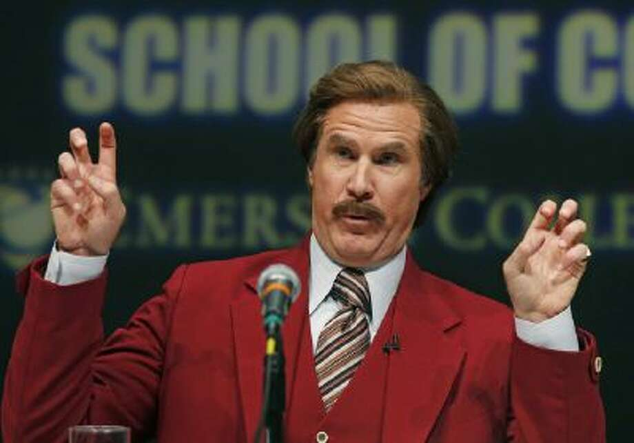 Actor and comedian Will Ferrell, who plays TV anchorman Ron Burgundy, stays in character during a news conference at Emerson College in Boston, Wednesday, Dec. 4, 2013.
