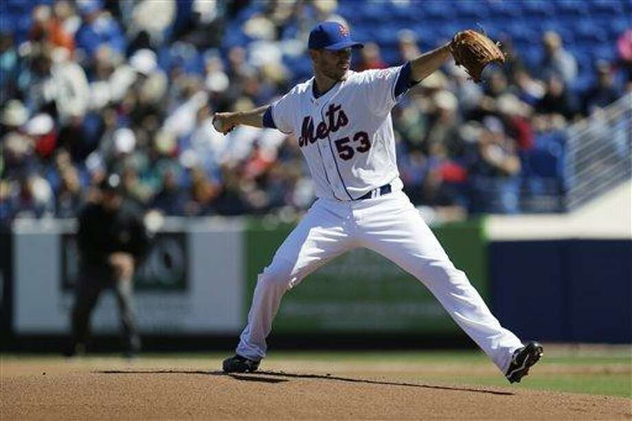 New York Mets relief pitcher Jeremy Hefner throws during the first inning of an exhibition spring training baseball game against the Atlanta Braves, Monday, March 4, 2013, in Port St. Lucie, Fla. (AP Photo/Julio Cortez) Photo: AP / AP
