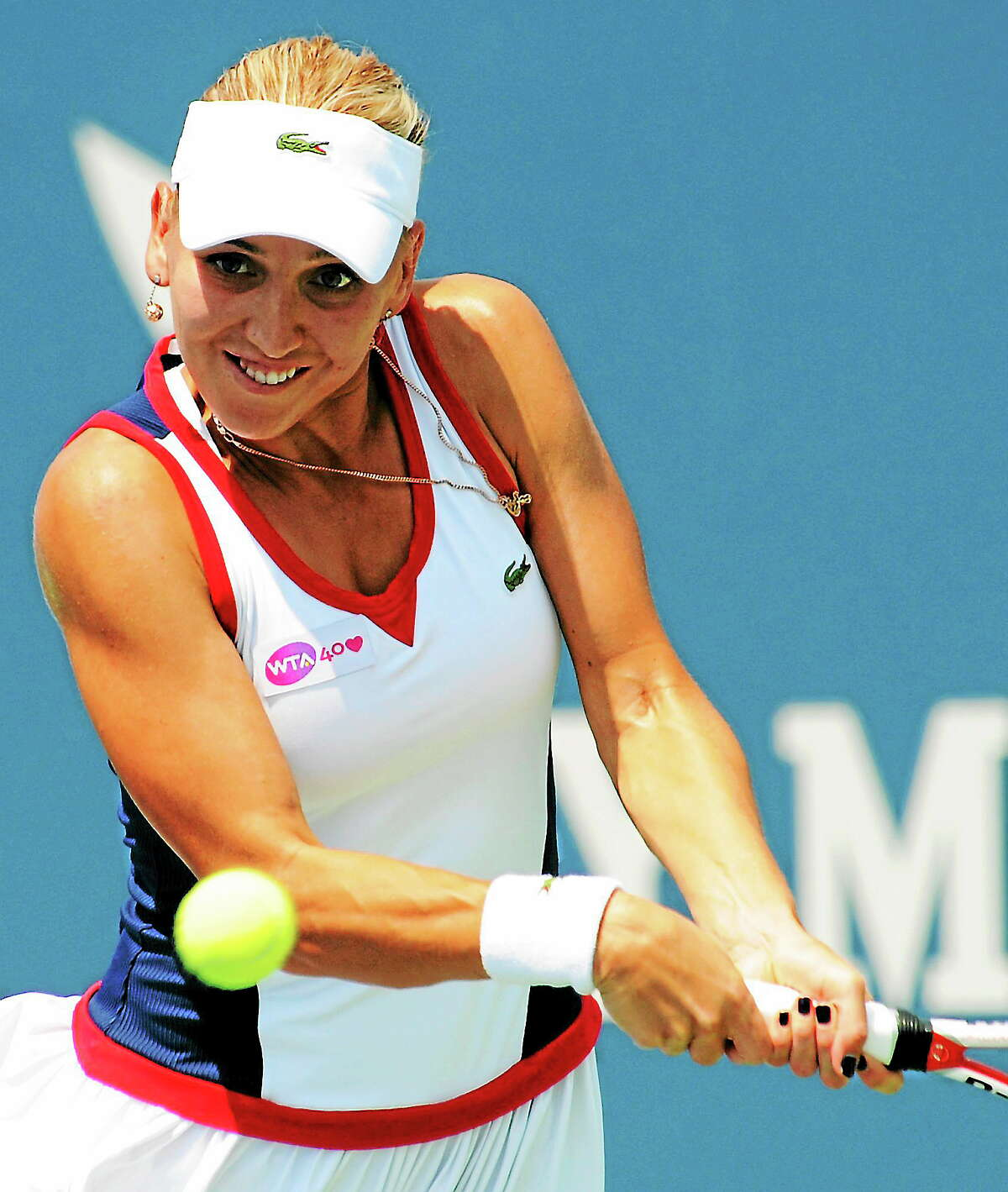 Elena Visnina hits a return to Angelique Kerber at the New Haven Open, Tuesday, Aug. 20, 2013.