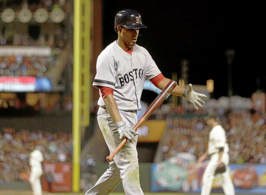 Boston Red Sox Xander Bogaerts walks back to the dugout after striking out against the San Francisco Giants during the sixth inning of a baseball game on Tuesday, Aug. 20, 2013, in San Francisco. (AP Photo/Marcio Jose Sanchez) Photo: AP / AP