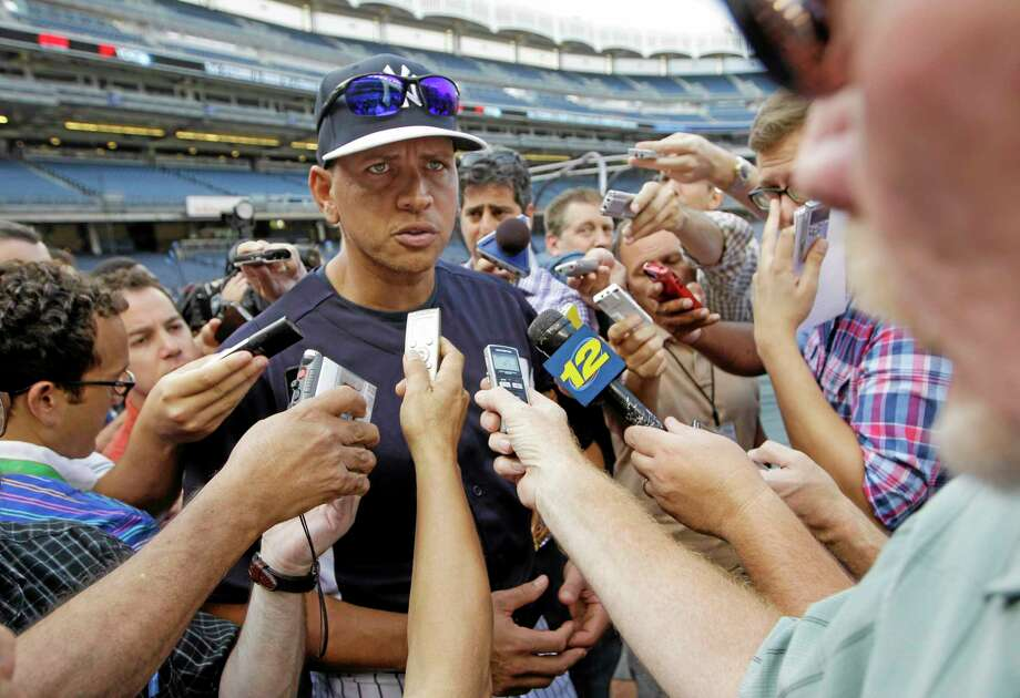 New York Yankees' Alex Rodriguez addresses a media swarm before a baseball game against the Toronto Blue Jays at Yankee Stadium, Wednesday, Aug. 21, 2013, in New York. (AP Photo/Kathy Willens) Photo: AP / AP
