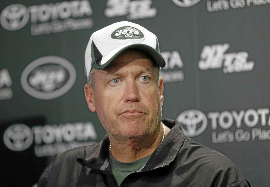 New York Jets head coach Rex Ryan talks to reporters after a practice in Florham Park, N.J., Monday, Aug. 19, 2013. (AP Photo/Seth Wenig) Photo: AP / AP