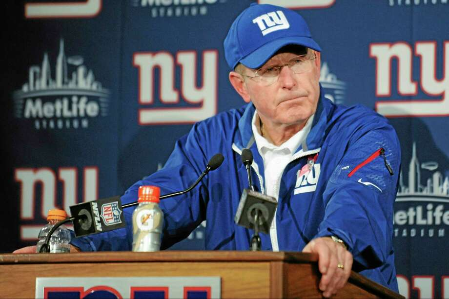Giants head coach Tom Coughlin responds to questions during a news conference on Sunday. Photo: Bill Kostroun — The Associated Press   / FR51951 AP
