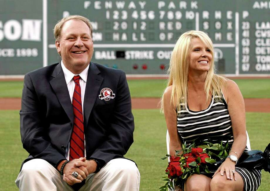Curt Schilling, left, is selling off furniture, sports collectibles and even artificial plants from his Massachusetts home. Photo: Winslow Townson — The Associated Press   / FR170221 AP