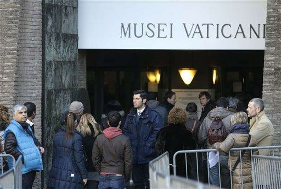 """People queue to enter the Vatican Museums, at the Vatican Thursday, Jan. 3, 2013. It's """"cash only"""" now for tourists at the Vatican wanting to pay for museum tickets, souvenirs and other services after Italy's central bank decided to block electronic payments, including credit cards, at the tiny city state. The Italian daily Corriere della Sera reported Thursday that Bank of Italy took the action because the Holy See has not yet fully complied with European Union safeguards against money laundering. That means Italian banks are not authorized to operate within the Vatican, which is in the process of improving its mechanisms to combat laundering. The Vatican says it's scrambling to find a non-Italian bank to provide the electronic payment services """"quite soon"""" but declined to discuss Bank of Italy's concerns. The central bank had no immediate comment on the situation. (AP Photo/Alessandra Tarantino) Photo: AP / AP"""