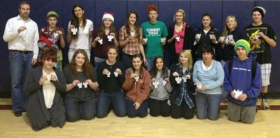 Photo submitted by TVHSStudents at Twin Valley High School recently came together to make 26 stained glass angels for students at Sandy Hook Elementary School in Newtown, Conn. Those who took part included: front row from left -- Christine Reilly, Caitlyn Reilly, Hannah Swanson, Sammy Cunningham-Darrah, Kirsten Halbur, Jade Waters, Ms. Dawn Borys and Adam Robertson; back row from left -- Mr. Aaron Wood, Baylee Crawford, Ms. Christy Abraham, Katrina Aldrich, Jordan LaBonte, Dal Nesbitt, Abbi Molner, Alex Kennedy, Savannah Nesbitt and Nick Nilson.