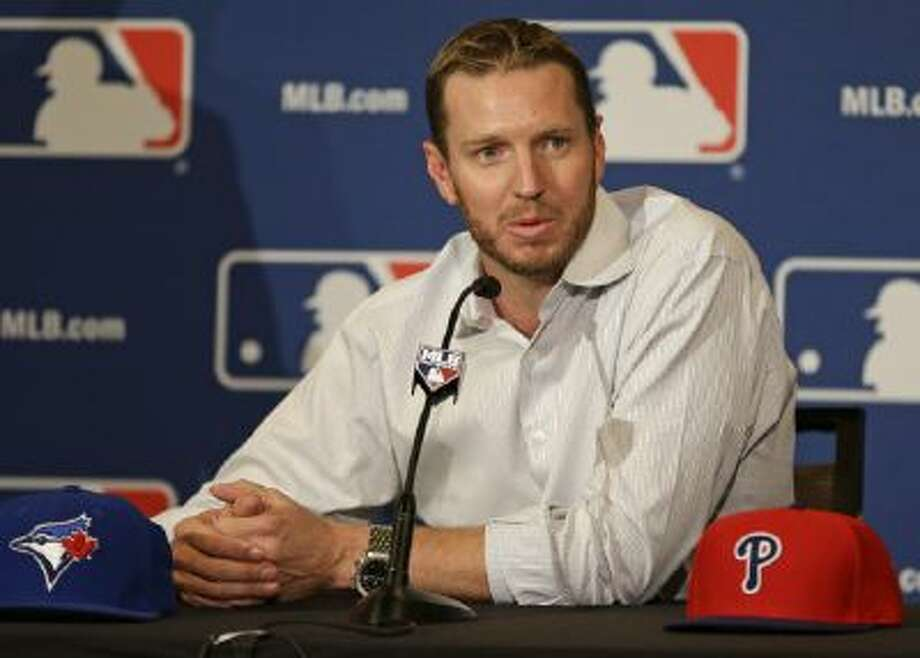 Two-time Cy Young Award winner Roy Halladay answers questions after announcing his retirement after 16 seasons in the major leagues with Toronto and Philadelphia at the MLB winter meetings in Lake Buena Vista, Fla., Monday, Dec. 9, 2013.