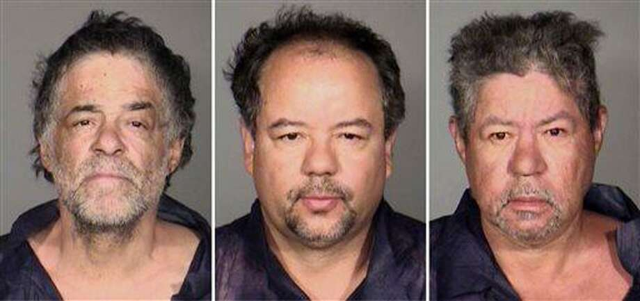 This undated combination photo released by the Cleveland Police Department shows from left, Onil Castro, Ariel Castro, and Pedro Casto.The three brothers were arrested Tuesday, May 7, 2013, after three women who disappeared in Cleveland a decade ago were found safe Monday. The brothers are accused of holding the victims against their will. (AP Photo/Cleveland Police Department) Photo: AP / Cleveland Police Department