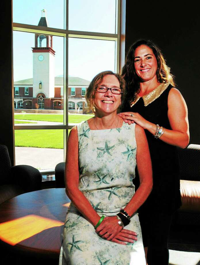 Photo by Peter Hvizdak — New Haven RegisterMaureen Helgren,  Quinnipiac University Associate Professor and Physical Therapy Department Chair, left, and Tami Reilly (CQ), Quinnipiac University Associate Athletic  Director for Fitness and Wellness at Quinnipiac University Thursday August 15, 2013. Helgren and Reilly, with several Quinnipiac University students, recently traveled to Guatemala to distribute donated wigs to indigent female cancer patients who lost their hair to chemotherapy. Photo: New Haven Register / ©Peter Hvizdak /  New Haven Register