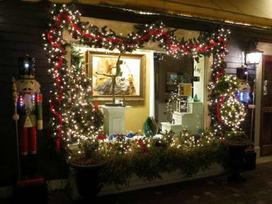 hops on the Washington Street Mall in Cape May, N.J., shown on November 23, create special window displays for Christmas.