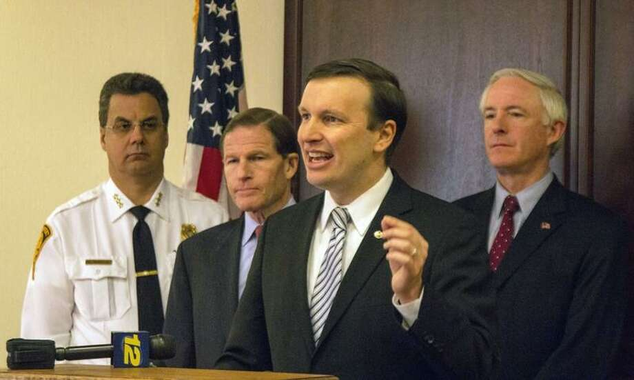 Left to right: Bridgeport Police Chief Joseph Gaudett Jr., U.S. Sen. Richard Blumenthal, U.S. Sen. Chris Murphy and Bridgeport Mayor Bill Finch advocate for stricter straw purchasing penalties for firearms. Photo by Rich Scinto