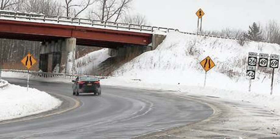 "Dispatch Staff Photo by JOHN HAEGER <a href=""http://twitter.com/oneidaphoto"">twitter.com/oneidaphoto</a> A car passes under the damaged Route 24 underpass en route to Rome on Route 365."