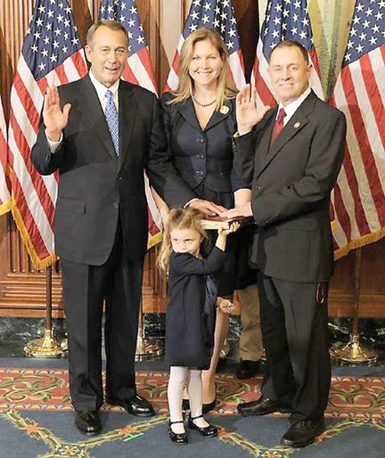 Photo Courtesy U.S. Rep. Richard Hanna  House Speaker John Boehner, left, ceremonially swears in U.S. Rep. Richard Hanna, R-22. With him is his wife, Kim, and their 4-year-old daughter, Grace. Their 5-year-old son, Emerson is hiding behind the group; his khaki pants and black shoes are visible.