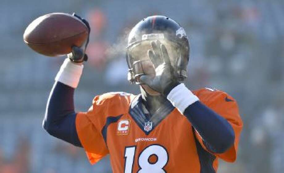 Peyton Manning warms up before the Broncos-Titans game.