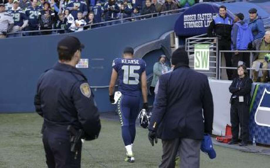 Seattle Seahawks' wide receiver Jermaine Kearse (15) walks to the locker room with a trainer after suffering a concussion against the Minnesota Vikings.