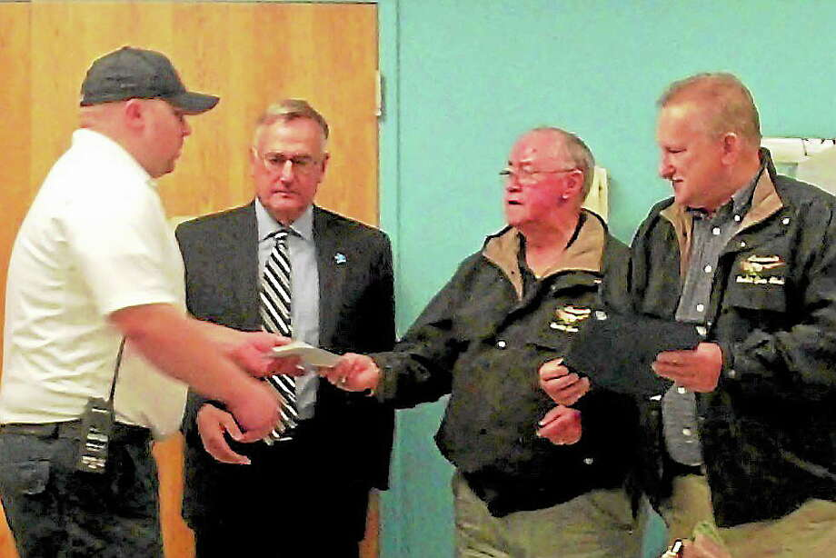 LEFT TO RIGHT: ARMS CHIEF JARED HEON, ANSONIA MAYOR JAMES DELLA VOLPE ANSONIA ROD & GUN CLUB TREASURER HORACE BEHRLE AND ANSONIA ROD & GUN CLUB PRESIDENT WARREN CONNORS. (Jean Falbo-Sosnovich/New Haven Register) Photo: Journal Register Co.