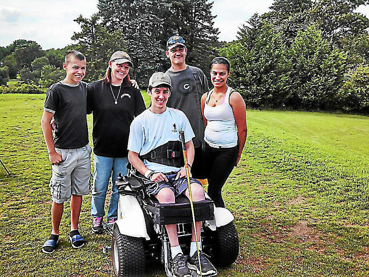 CONTRIBUTED PHOTO Spc. Sean Pesce, paralyzed from the waist down during a 2012 firefight in Afghanistan, is hoping to return home to West Haven by March. His family is currently trying to raise enough money to make their home more accessible.