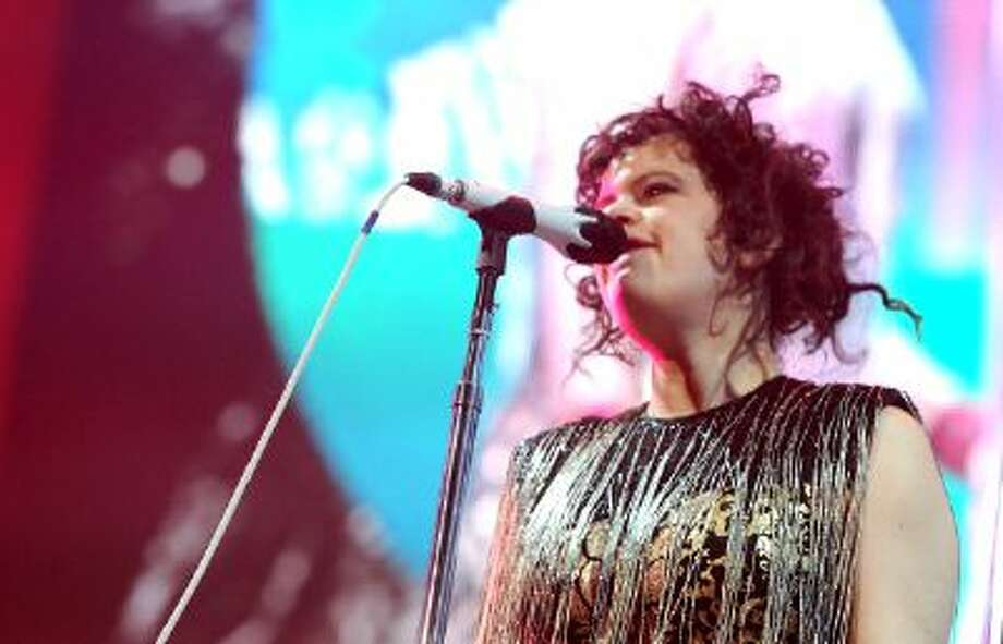 Régine Chassagne of Arcade Fire performs onstage during The 24th Annual KROQ Almost Acoustic Christmas at The Shrine Auditorium on December 8, 2013 in Los Angeles, California. / 2013 Getty Images