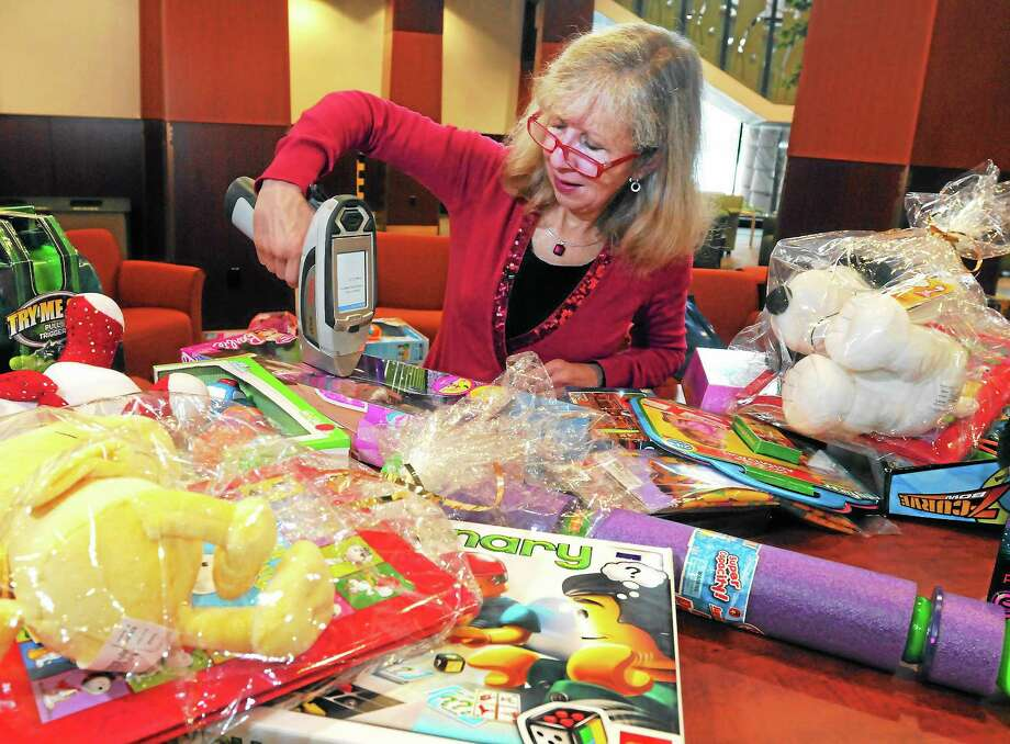 """Quinnipiac University's Occupational Therapy Associate Prof. Martha """"Marcy"""" Sanders uses a XRF Fluorescence spectrometer to check toys donated during the university's annual toy drive for lead and cadmium. Most, but not all, passed the test. Photo: (Mara Lavitt — New Haven Register)    / Mara Lavitt"""