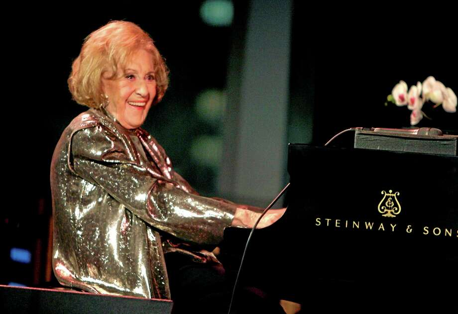 "FILE - In this March 19, 2008 file photo, Marian McPartland smiles while playing the piano during a celebration of her 90th birthday in New York. McPartland, 95, the legendary jazz pianist and host of the National Public Radio show ""Piano Jazz,"" died of natural causes Tuesday, Aug. 20, 2013 at her Port Washington home on Long Island. (AP Photo/Seth Wenig, File) Photo: AP / AP"