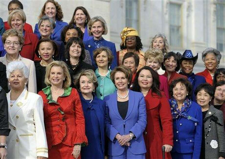 House Minority Leader Nancy Pelosi of Calif., front row, center, poses with other female House members on the steps of the House on Capitol Hill in Washington, Thursday, Jan. 3, 2013, prior to the official opening of the 113th Congress . (AP Photo/Cliff Owen) Photo: AP / FR170079 AP
