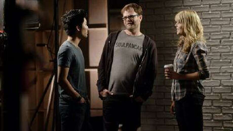 This undated publicity photo provided by Google Inc. shows, from left, Ryan Higa, Rainn Wilson and Grace Helbig shooting a video for YouTube's planned Comedy Week. From May 19-25, 2013, YouTube will host a themed week of comedy programming, featuring live-streams, videos and stand-up routines from comedy stars like Sarah Silverman and Jimmy Kimmel, as well as the less famous comedians of YouTube. (AP Photo/Google Inc., John Lindley) Photo: AP / Google Inc.