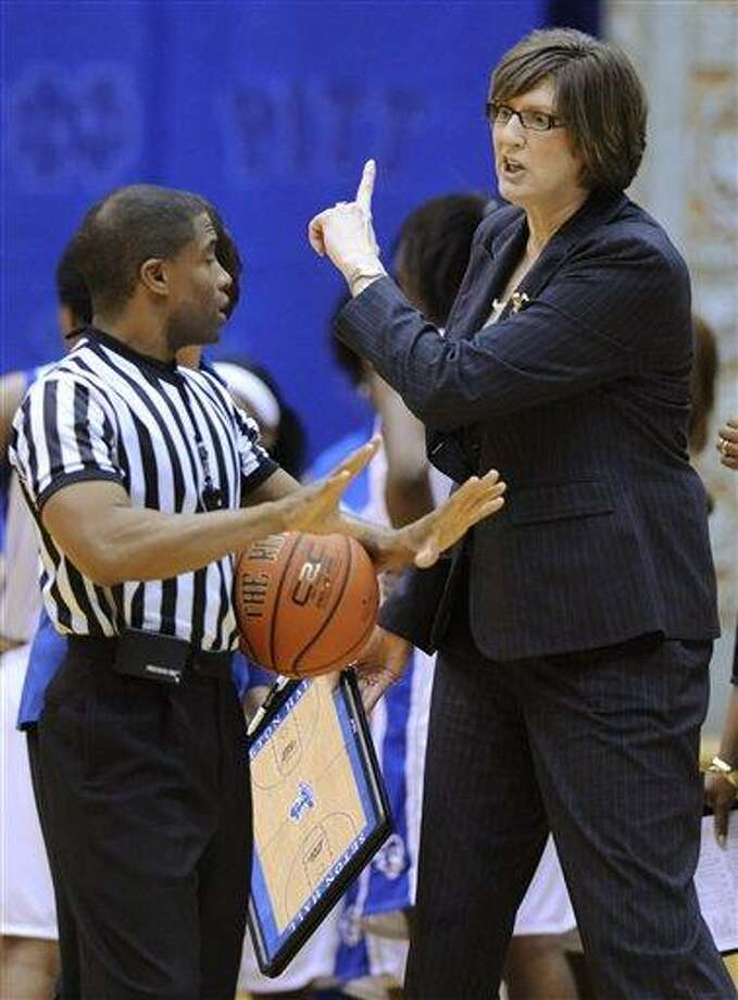 Seton Hall coach Anne Donovan, right, talks with referee Eric Brewton during the second half of an NCAA college basketball game against Rutgers on Monday, Feb. 28, 2011 in South Orange, N.J. Donovan was named head coach of the Connecticut Sun on Thursday.(AP Photo/Bill Kostroun) Photo: ASSOCIATED PRESS / AP2011