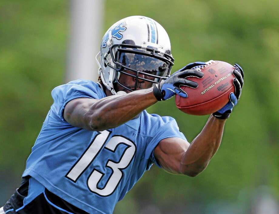 FILE - In this July 26, 2013 file photo, Detroit Lions receiver Nate Burleson runs through drills during an NFL football training camp in Allen Park, Mich. Burleson and Ryan Broyles appear to be healthy after having season-ending injuries, and the Detroit Lions need them to be because receiver Calvin Johnson needs some help. (AP Photo/Carlos Osorio, File) Photo: AP / AP