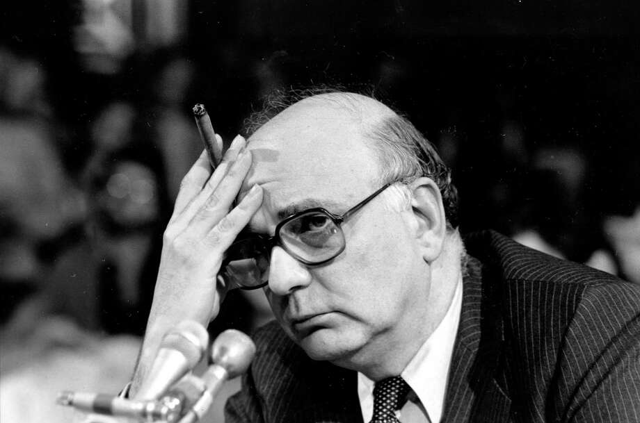 FILE - In this March 18, 1980, file photo, Federal Reserve Board Chairman Paul Volcker listens to a question as he appears before the Senate Banking Committee in Washington, D.C.  The Federal Reserve and the Federal Deposit Insurance Corp. each unanimously voted to adopt the so-called Volcker Rule, taking a major step toward preventing extreme risk-taking on Wall Street that helped trigger the 2008 financial crisis. The rule which states that U.S. banks will be barred in most cases from trading for their own profit under a federal rule is named after Paul Volcker, a former Fed chairman who was an adviser to President Barack Obama during the financial crisis. (AP Photo/Chick Harrity, File) Photo: AP / AP